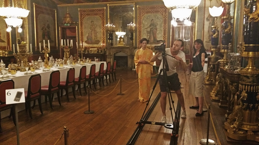 Andrew Nicholls filming his work Gulchenrouz with model Luca Gatti and Dr. Alexandra Loske from the Royal Pavilion and Museums, Brighton. Image c/o Alexandra Loske, with thanks to the Royal Pavilion and Museums, Brighton.