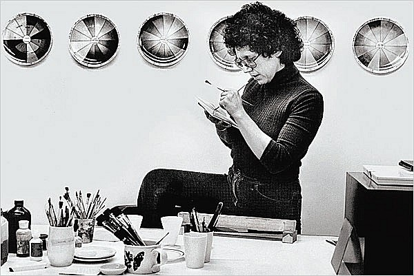 Image credit - Judy Chicago at work in her china-painting studio in 1974. Courtesy of Through the Flower Archives