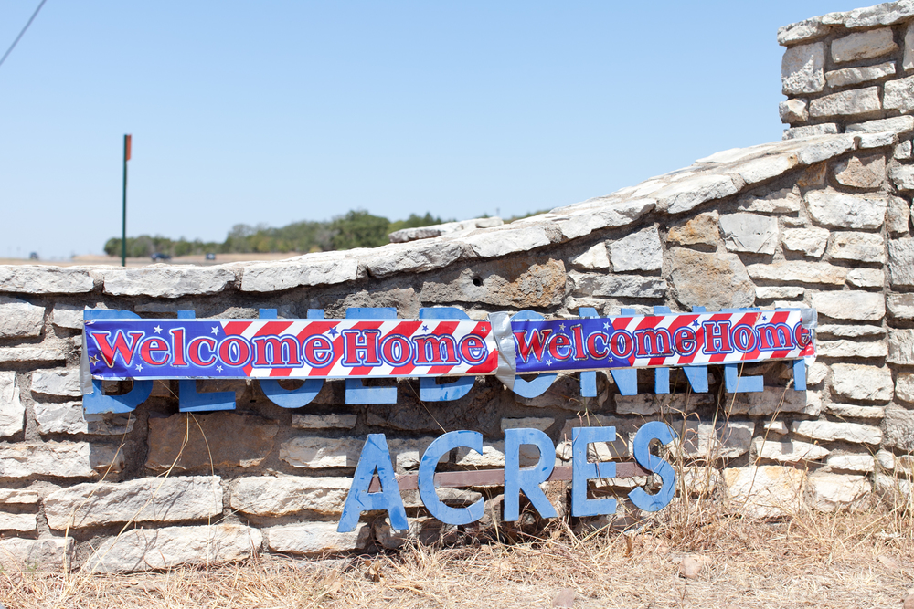 A banner welcoming home the residents of theBluebonnet Acres neighborhood in Cedar Creek, Texas.
