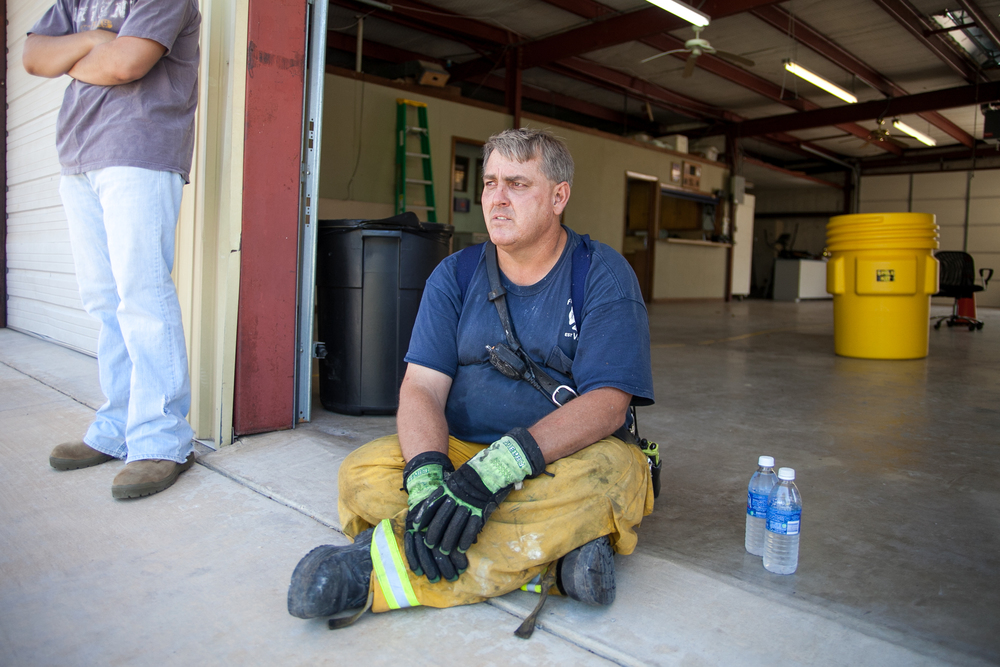 Kevin Giesalhart, fire chief from neighboring Five Points Fire Department, takes a break from fighting fires.