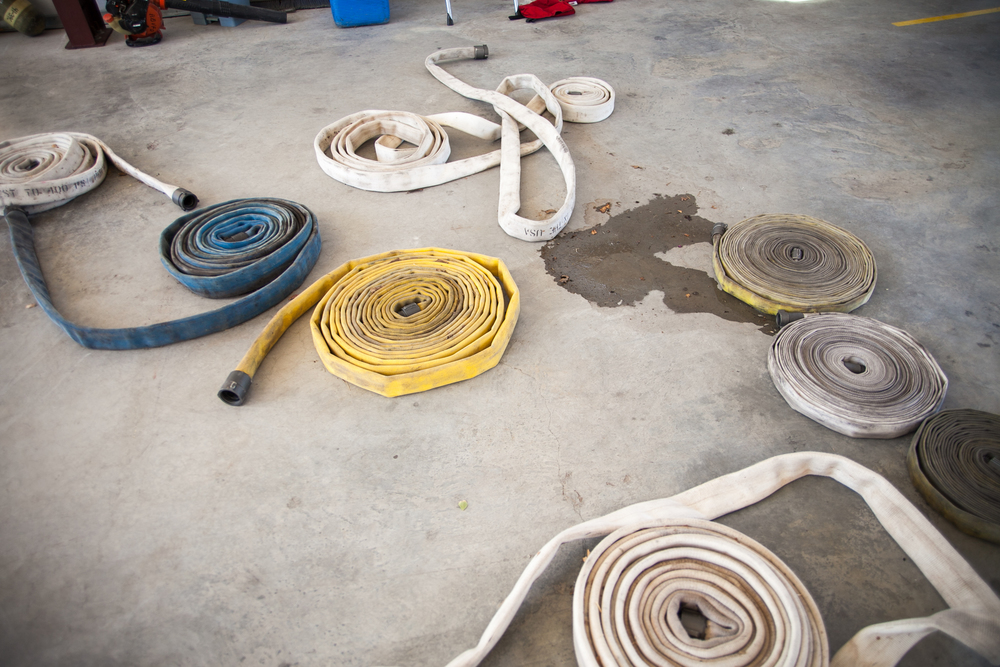Coiled hoses rest on the floor of the Bluebonnet Volunteer Fire Station in Cedar Creek, Texas.
