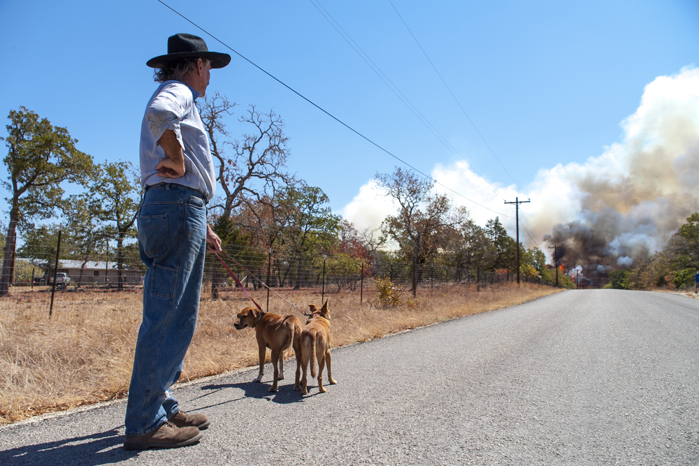 John Raworth watches as high winds spread the fire inCedar Creek, Texason Labor Day 2011.