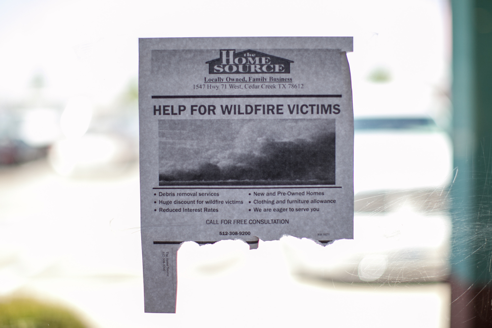 A flyer offering help to wildfire victims at a Taco Cabana in Bastrop, Texas.
