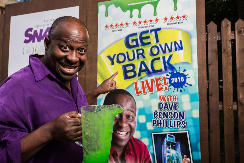 Dave Benson Phillips with his green gunge and poster