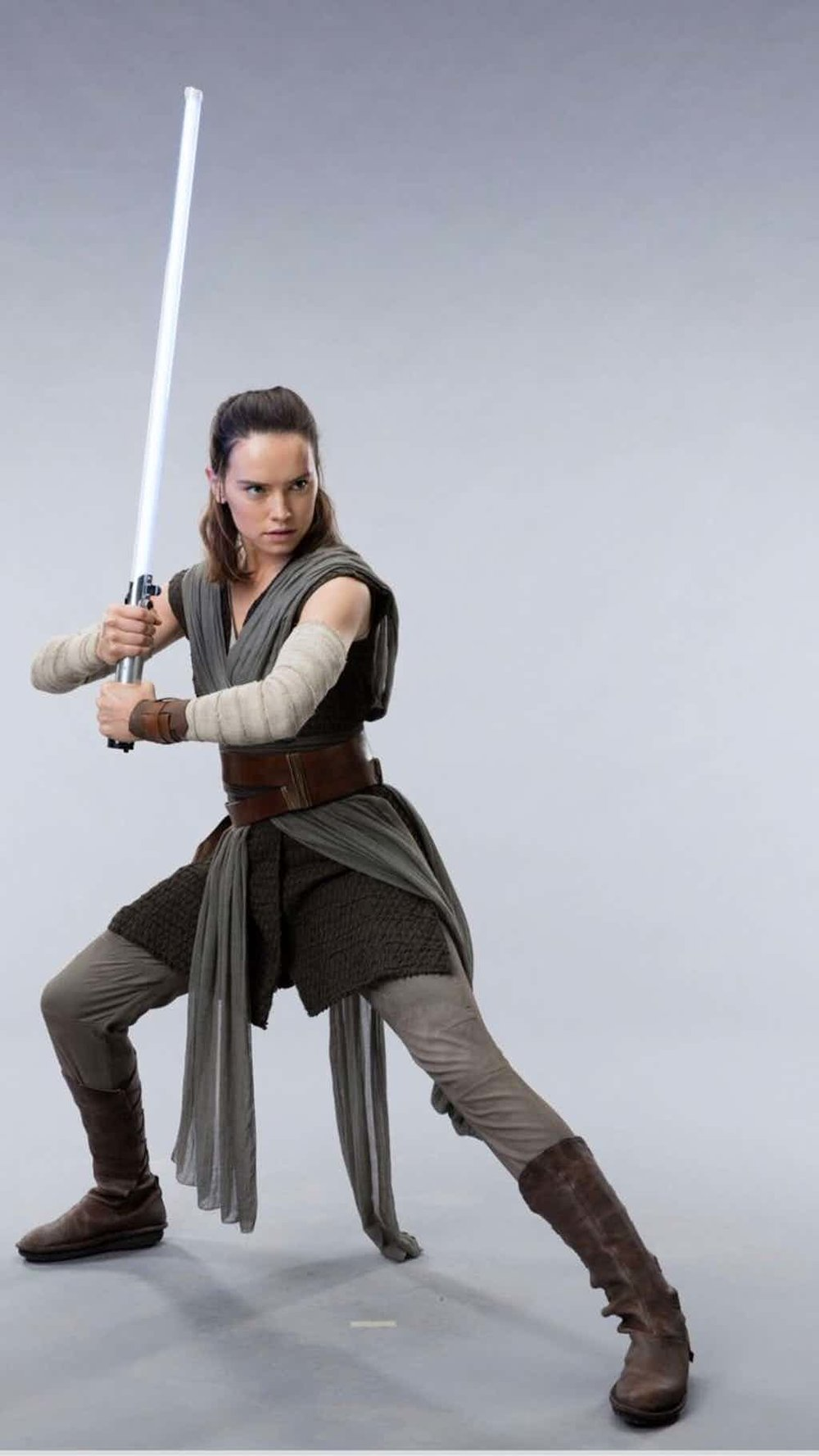 Star-Wars-The-Last-Jedi-Daisy-Ridley-as-Rey-Promo-Post-With-Prop-Lightsaber.jpg