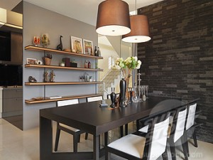 Brick wall and dining room table in small dining room