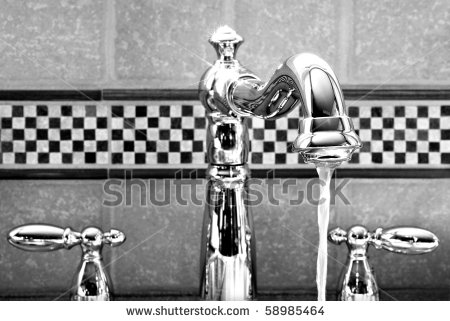 stock-photo-shiny-new-stainless-steel-victorian-styled-faucet-with-ceramic-tile-backsplash-black-and-white-58985464