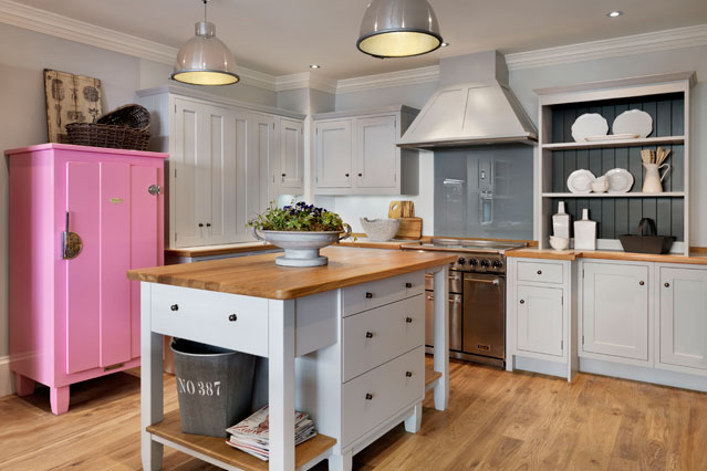 white kitchen with pop of pink