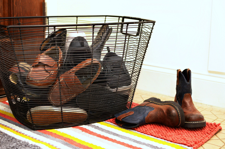 shoes get so messy at the front door and we often get lazy about putting them in a cupboard - what about a basket? resolve to always put your shoes inside the basket for a much neater front hall