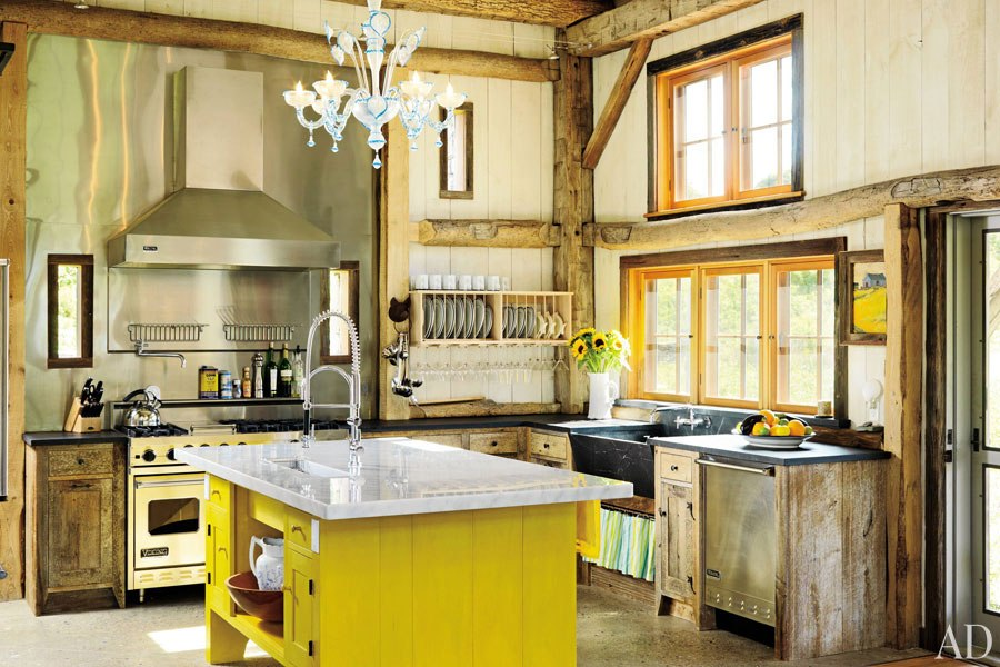 stylish-chandelier-and-steel-backsplash-behind-stove-also-yellow-island-cabinets-plus-black-sink-in-rustic-kitchen-idea.jpg