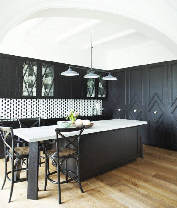 the diamond pattern is repeated on the wall of built-ins, the glass fronted cabinets and even in the backsplash