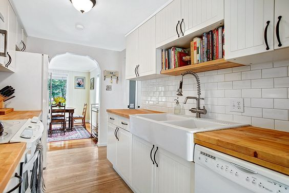 Combine butcher block with simple white cabinetry so that white appliances look intentional and beautiful.