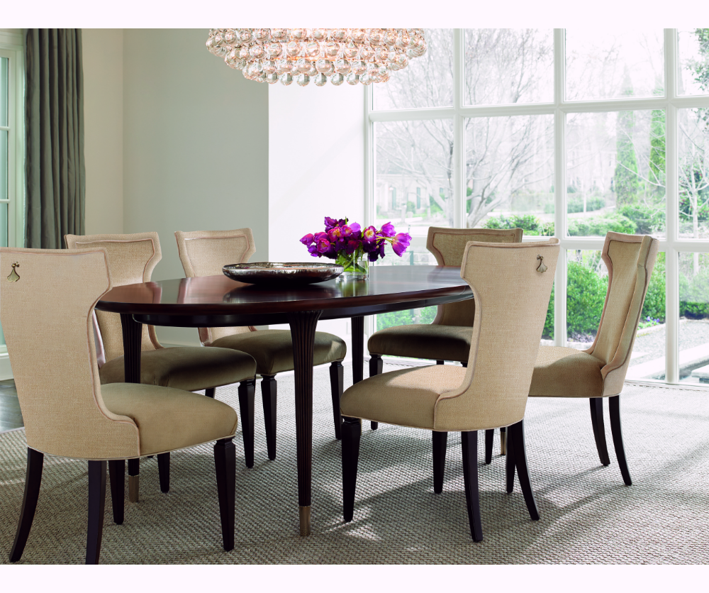 "For a more sophisticated look for larger spaces, this grand Chatillon extension table from Decorium has a gorgeous finish and two 22"" leaves for XL dinner parties."