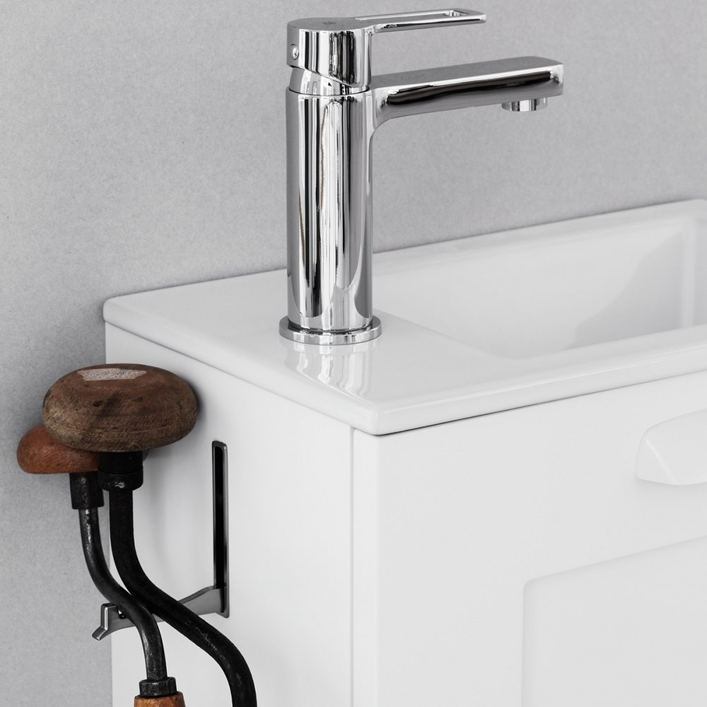 faucet with old woodworking tools.jpg