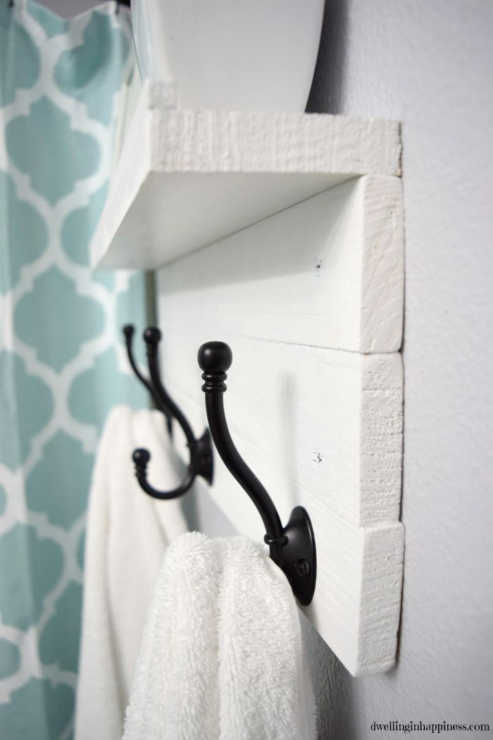 Add special hooks, possibly hung on a simple DIY like this one.