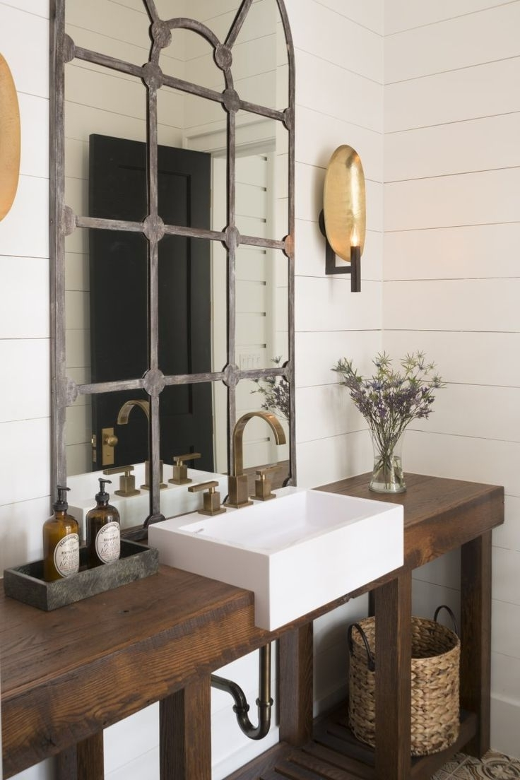 Add a really unique mirror... and some shiplap on the walls is pretty sweet too!