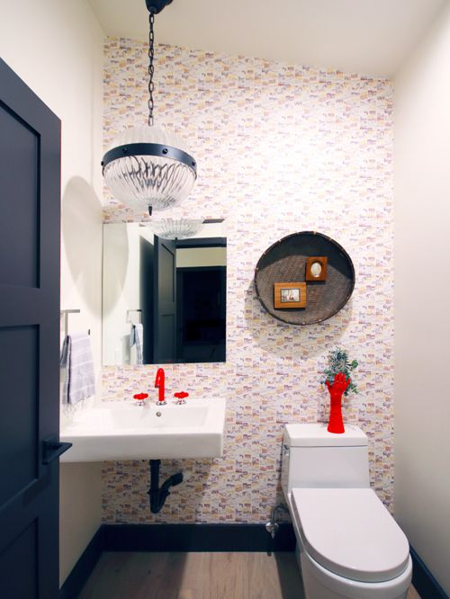 A dramatic light fixture can be part of a series of beautiful things in a powder room - here it looks great coupled with a red faucet!