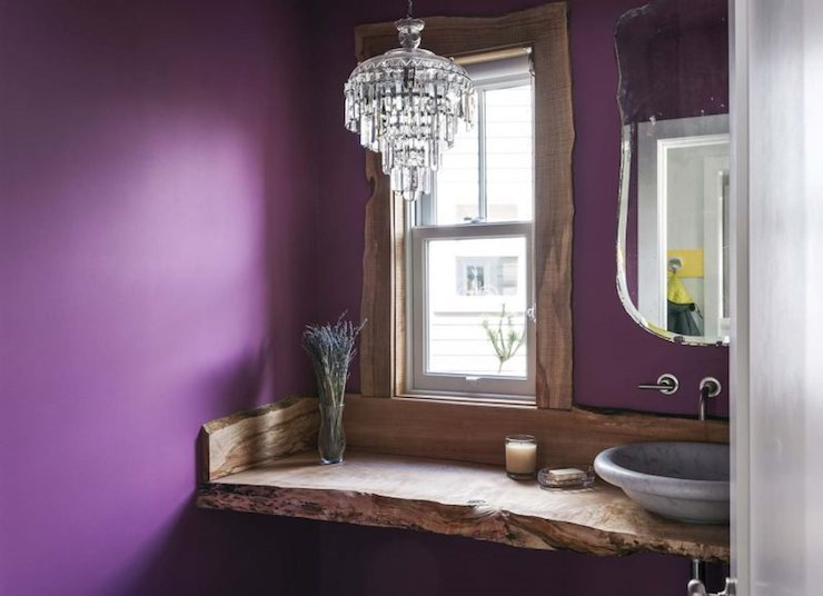 Be as eclectic as you like - here a vintage mirror and chandelier couples nicely with rustic wood and a marble bowl sink.