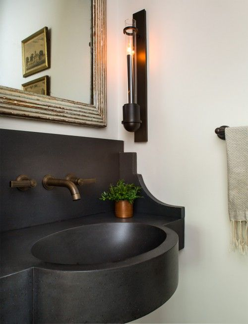A sink made out of stone with its own backsplash says 'look at me!'.
