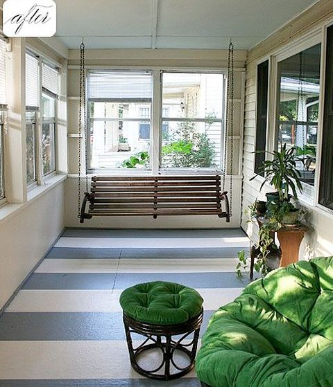 Add some paint to the floors! Painting stripes on a front porch sunroom is an easy way to add colour and fun.