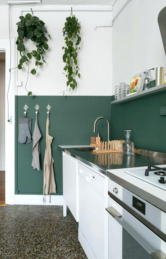 dark-green-walls-a-half-painted-dark-green-wall-is-used-as-a-and-adds-a-colorful-dark-green-walls-kitchen.jpg