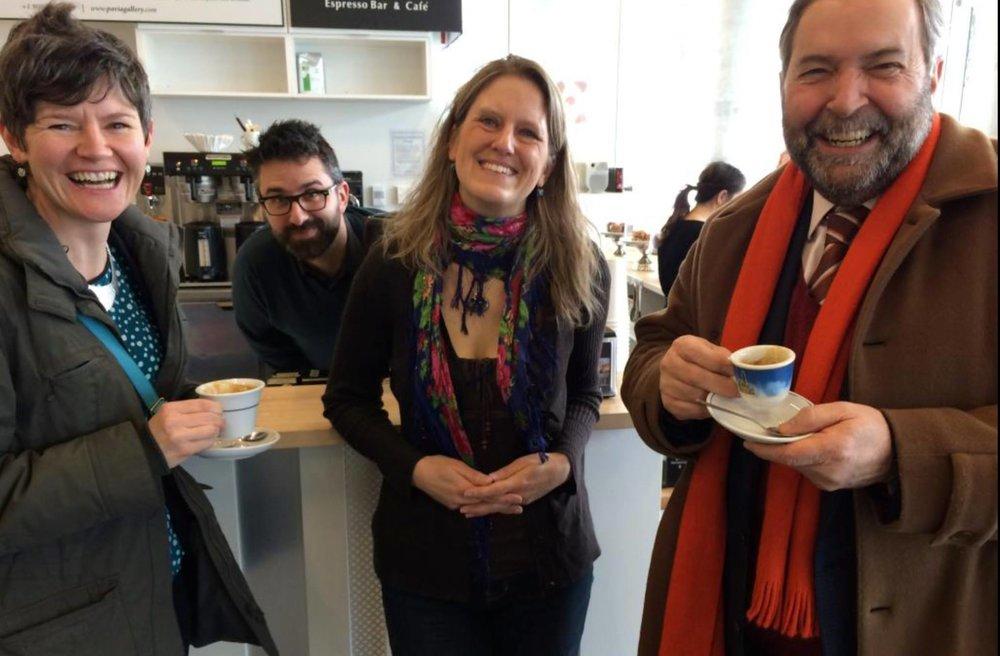 "Former NDP Leader Tom Mulcair along with PAVIA owners Christopher & Victoria enjoy the fruits of Megan Leslie's labour during ""Bad Cappuccino Day for the YWCA"""