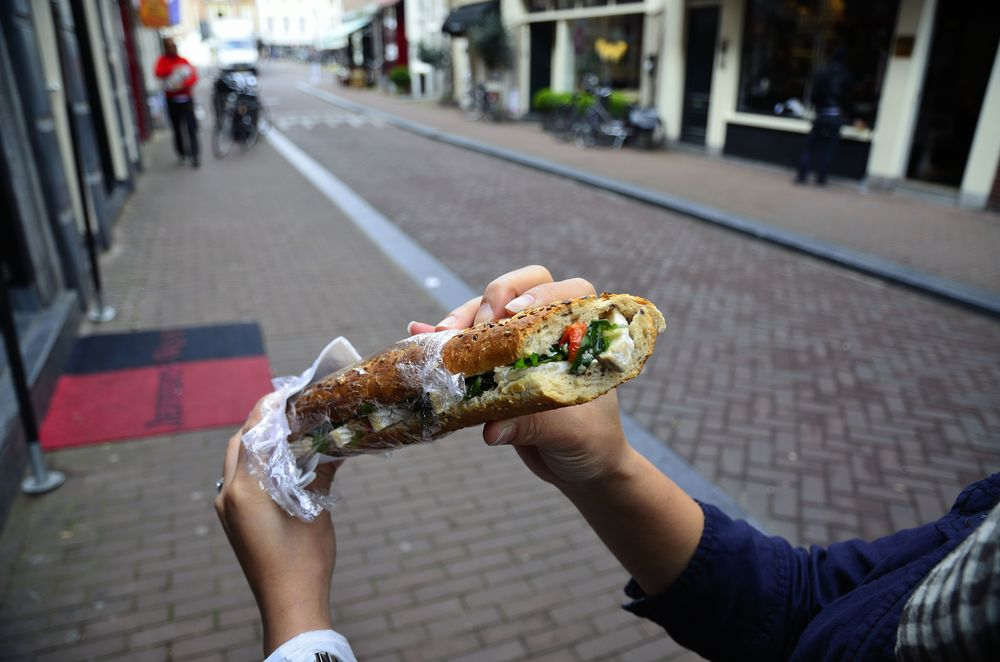 Eating a Brodje from De Kaaskamer in Amsterdam