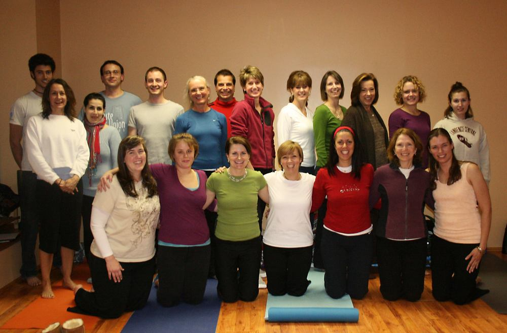Our amazing Cityoga Yoga Teacher Training Class. That's me in the peach tank on the end.