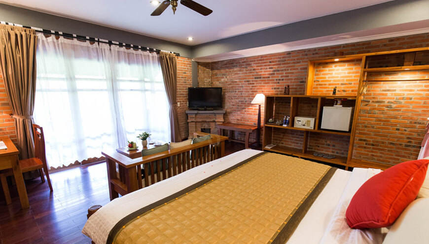 Pilgrim Village Resort, Hue  Deluxe-room-window-2.jpg