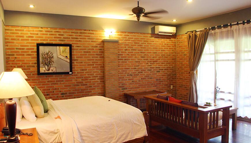 Pilgrim Village Resort, Hue Family-Deluxe-window.jpg