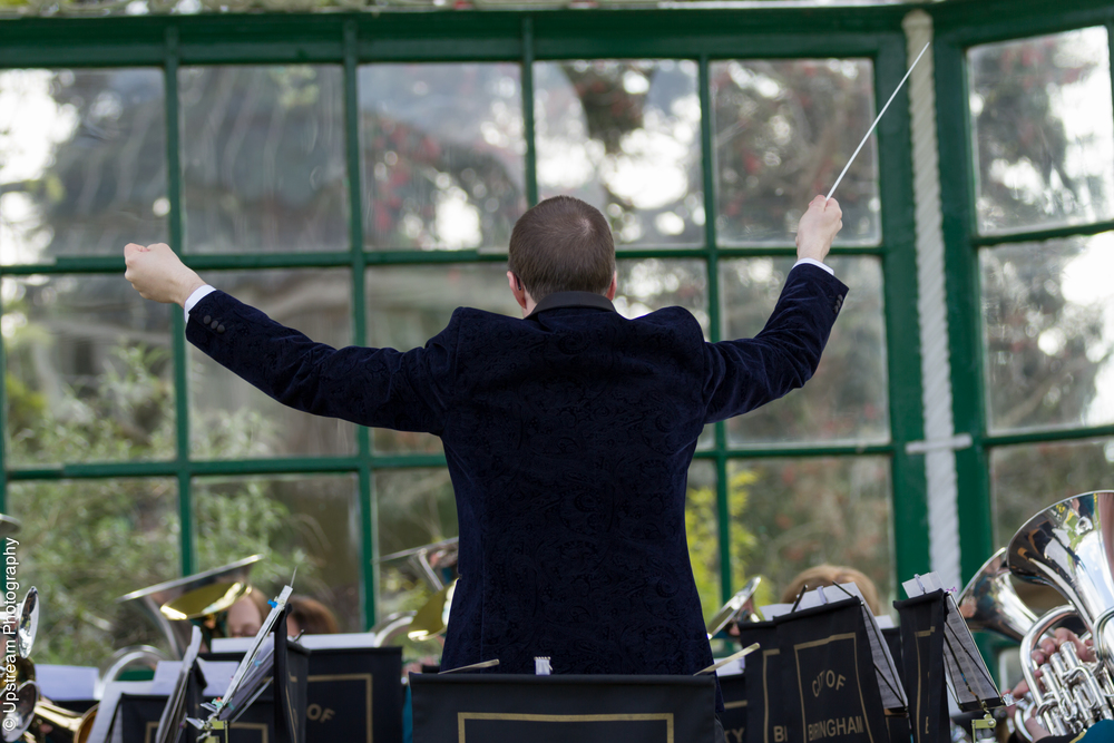 Iain Masson conducting City of Birmingham Brass Band in Birmingham on the bandstand at the Botanical Gardens.