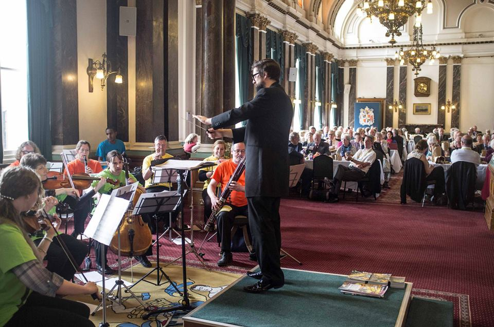Conducting players from The People's Orchestra to delegates and the Lord Mayor of Birmingham at the Rotary International Conference at Birmingham Council House.