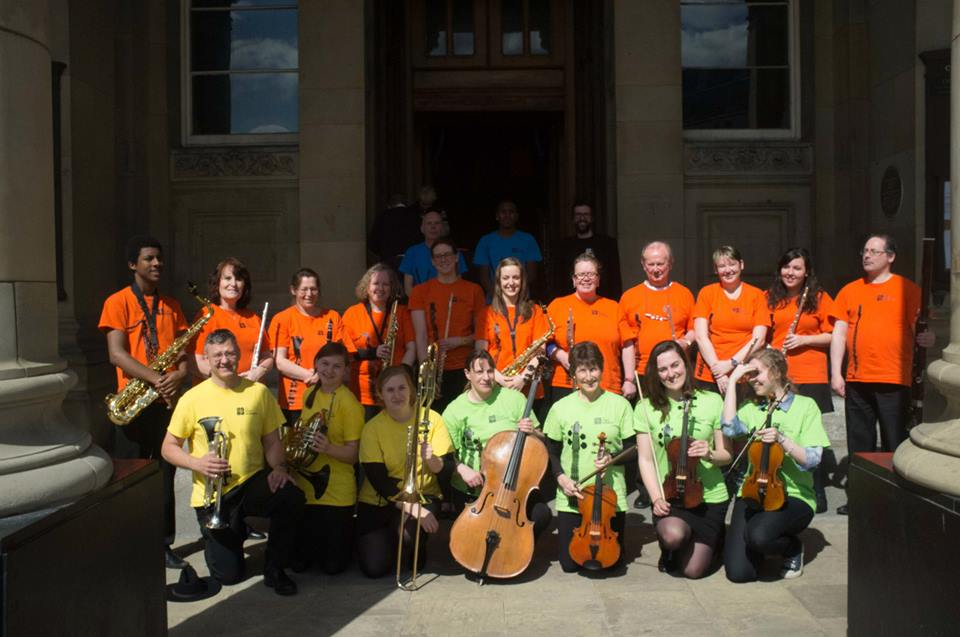 Pictured with musicians from The People's Orchestra outside Birmingham Council House after a Rotary Conference performance