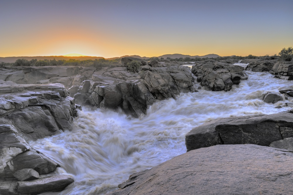 A second view of the top of the Augrabies Falls at dawn on the Orange River.
