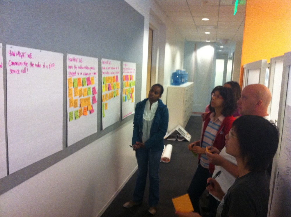 """A """"How Might We"""" concepting session with the team, using the insights and guiding principles from the discovery phase of the project ."""