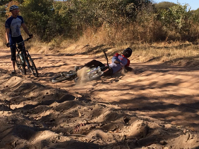 William eats sand on the road to Kalomo.