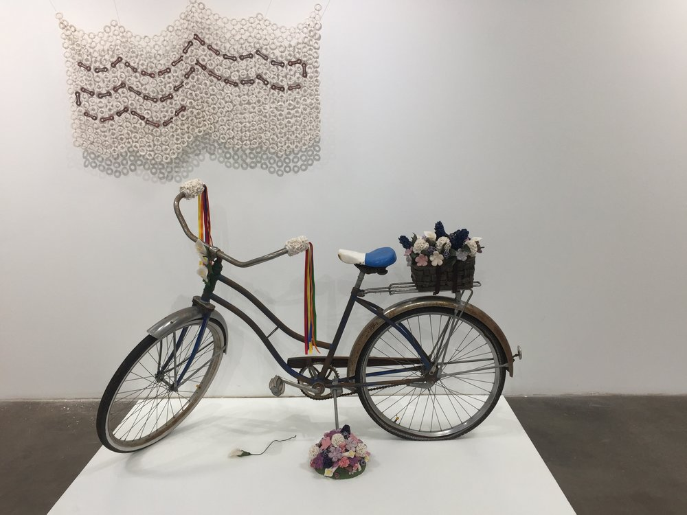 "This was a piece of art that was created by the mother of one of our riders that was on show at an art event in Houston. She said, ""In the tradition of mothers making quilts to honor important events in their children's lives, I have created a porcelain quilt in the shapes of wheels and bicycle chains. Each rider's name is on one link of the chain to reinforce the idea that just as the chain turns the wheels and drives the bike forward, these 38 people are working together to raise money and awareness"". She did just that!"