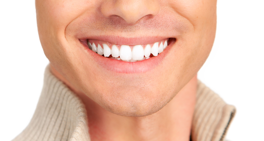 shutterstock-man-smile-closeup-white-teeth.jpg