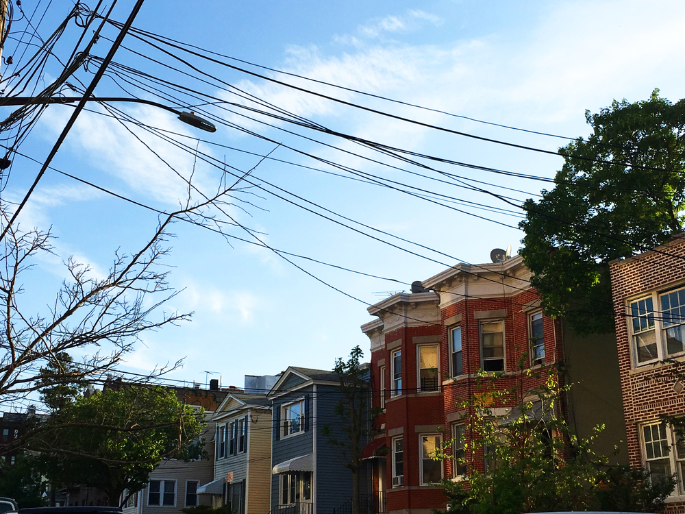 One of my favorite parts of Queens is the tree lined streets and quaint colored buildings
