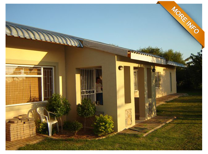 Ref: PT0026 | Beautiful piece of bushveld property.       Home with 4 Bedrooms, 2 bathrooms, dressing room. Electric fencing,     automatic gate, 2 equipped boreholes, large barn, 2 car ports and pool.        PRICE: R1 800 000