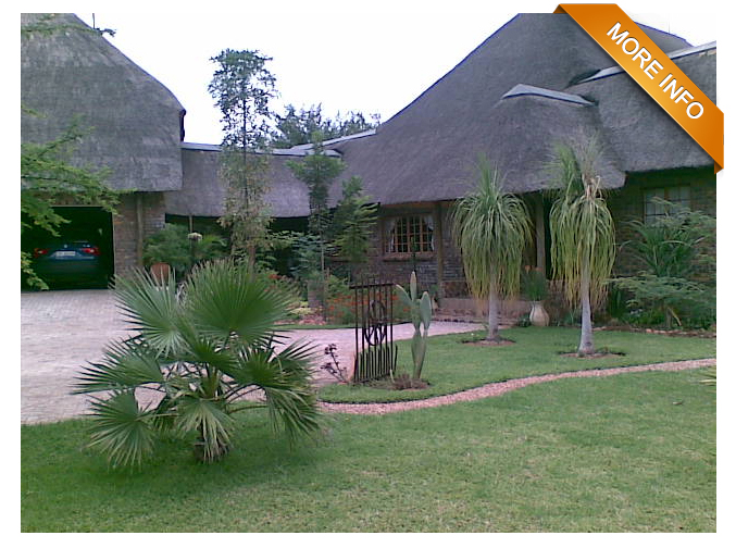 Ref: PT0001 |   Strong water supply.        1 Ha smallholding with beautiful 650 sqm thatched home and garage.      Spacious kitchen with scullery, laundry, separate ironing room and    fridge room. Lovely patio, lapa and bar.  Airconditioned rooms and much more!         PRICE: R3 750 000