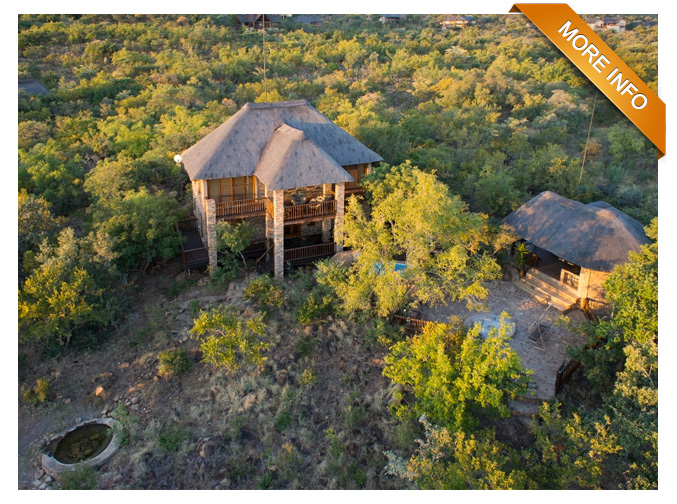 PTY52  |  Lovely bushveld home with 3 en-suite bedrooms.  Open-plan kitchen, living room which opens onto wooden deck. Entertainment loft with lounge. Separate thatched lapa with outdoor showers, kitchen and storeroom.  Rock pool overlooking bushveld views & open-air boma.  Game Drive Vehicle included. PRICE: R3 100 000