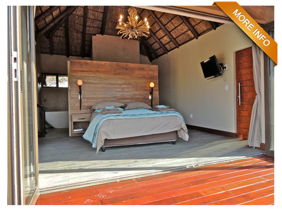 PRM053  |  From R3 300 per night Exquisite newly-built bushveld holiday home with spectacular views! Tastefully furnished with large open-plan lounge, kitchen & dining area 2 superior en-suite bedrooms with air-conditioning Upstairs loft with 3 single beds plus private bathroom Sparkling swimming pool on wooden deck Open-air boma & braai area Carports & full DSTV PRICE: R3 300 PER NIGHT (Out of Season) PRICE: R3 700 PER NIGHT (Peak Season)