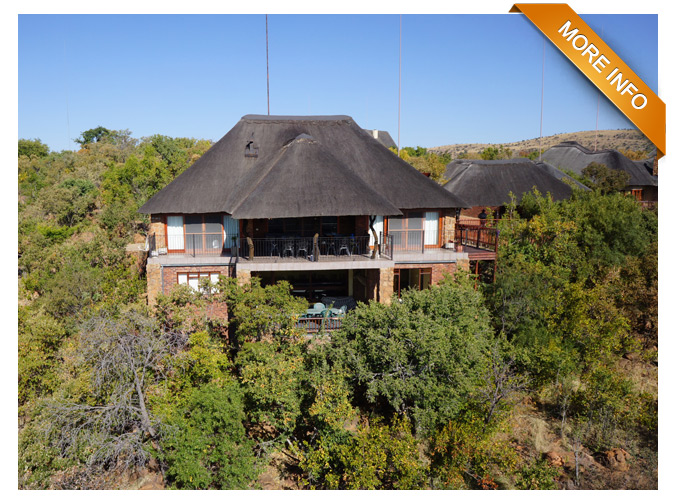 PRM010  |  From R4 790 per night     Includes daily cleaning except Wednesdays    Sleep 10 guests plus additional double sleeper couch  3 spacious double bedrooms (1 x en-suite)  2 full bathrooms with bath & shower  2 separate guest toilets & additional shower  Spacious entertainment area / kids' paradise with 4 single beds  Stunning north-facing views from patio & bedrooms  Spectacular bush-veld sunrises & sunsets from patio  Lounge / open-plan dining room / fireplace  Fully equipped large kitchen with dish washing machine  8-seater Jacuzzi, Pool Table & Dart Board  Rock Pool  DSTV / DVD plus free internet  Boma with braai - also gas braai available  Large downstairs verandah set amongst trees  Thatch-covered double parking plus ample open parking  Very private & serene! Wildlife Abounds!!!  Check in: 9.00am normally – (please confirm with agent)  Check out: 4.00pm on Sundays - (please confirm with agent)  OPTIONAL EXTRA: Game drive vehicle @ R 600 per stay      PRICE: R 4,790 PER NIGHT