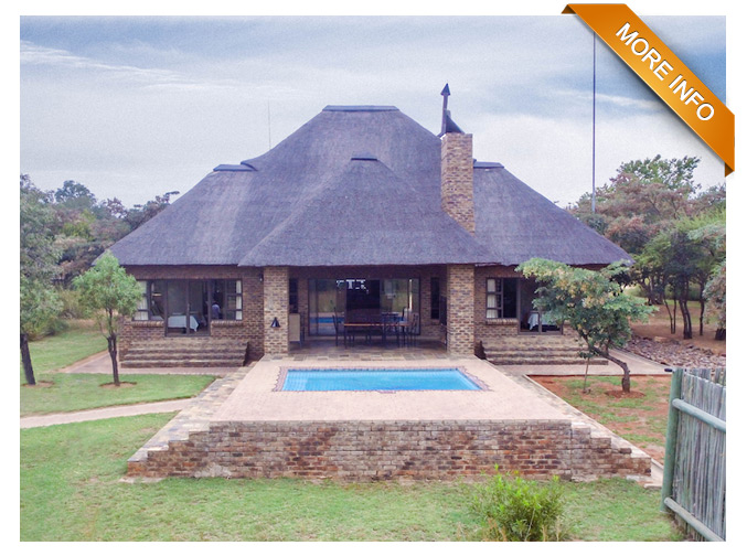 PRICE: R390 000 (10% share)   Spectacular home offering 4 en-suite bedrooms (two full bathrooms & two with showers only). Large open-plan lounge and fully equipped kitchen with coffee machine, ice machine, water filter, dishwasher, washing machine & tumble dryer. 4 air-conditioning units plus a fireplace for those chilly evenings. 4-seater golf cart available for the keen golf enthusiast or for an unique wildlife experience.
