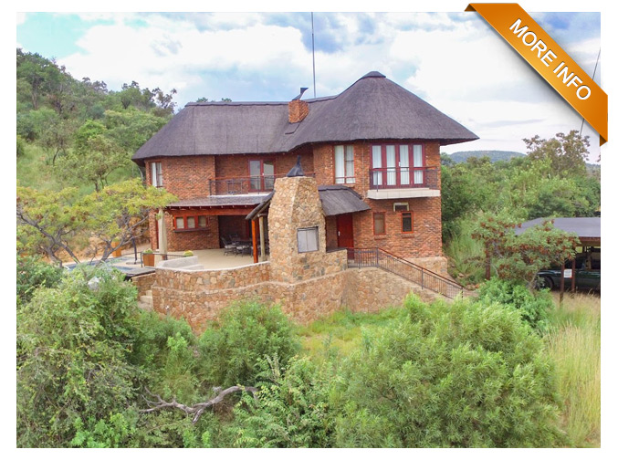 PSF 024 | SECLUDED ENTERTAINERS DREAM WITH A VIEW    PRICE: R400 000 (10% SHARE) Only 2 shares left   4 x luxury bedrooms with on suite bathrooms  Large open plan kitchen and dinning area  Bar with open plan lounge and fireplace separating area from dining/kitchen area  Big outdoor patio area with build in braai and Boma  Rim flow pool  Covered parking for 2 vehicles  Game viewer included  Quality Furniture and fittings