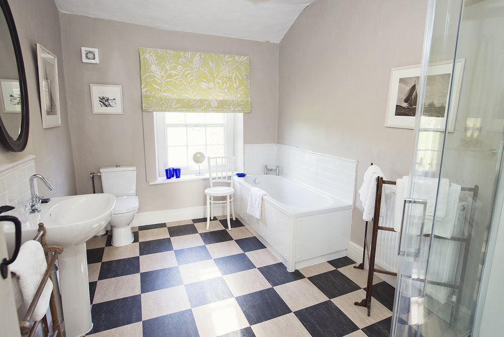 Church View bathroom with shower and bath
