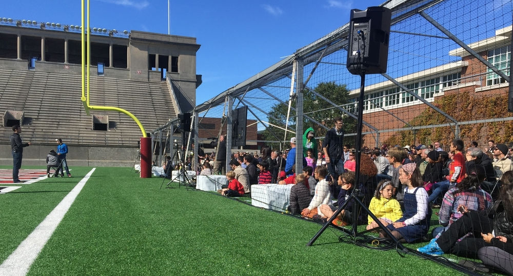 Spectators wait behind safety netting to watch the Drone Racing League