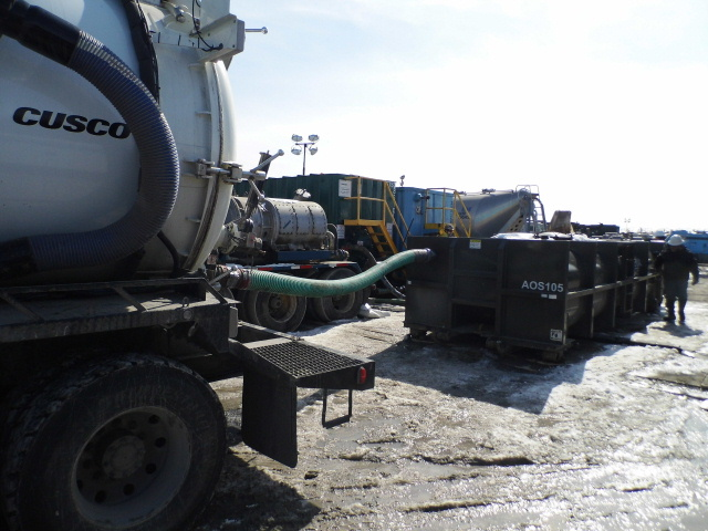 One of our rented vacuum trucks in action.