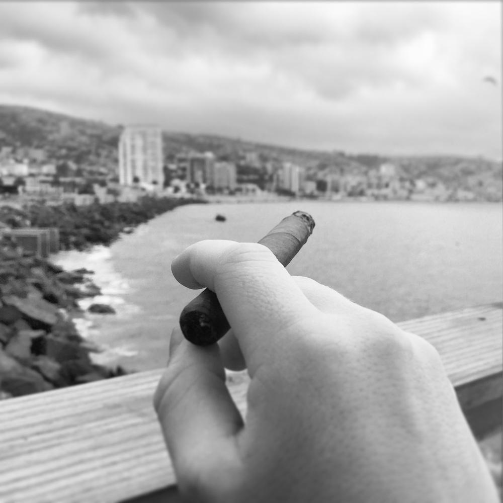 Smoking an original Habana cigar from Cuba, at Val Paraiso (Chile)